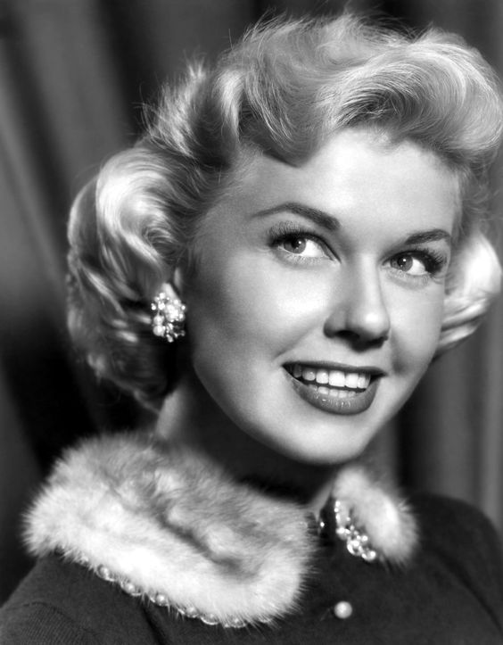 "DORIS DAY ~ Born: April 3, 1924, in Ohio, USA. Doris starred in ""Calamity Jane"" (1953), which was a major hit, & several more followed: ""Lucky Me"" (1954), ""Love Me or Leave Me"" (1955), ""The Man Who Knew Too Much"" (1956) & what is probably her best-known film ""Pillow Talk"" (1959). Made 5 films in the 60s. She briefly dated Ronald Reagan shortly after his divorce from Jane Wyman when she & Reagan were contract players at Warner Brothers. She now devotes her life to animals.."