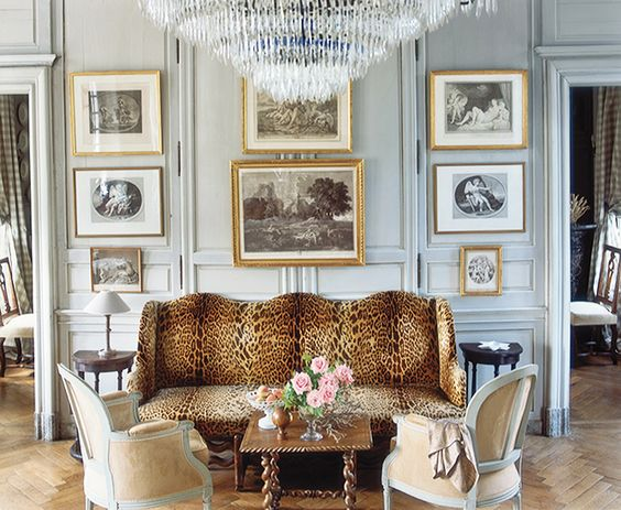 17 Beautifully Feminine Rooms to Get Inspired By// leopard sofa