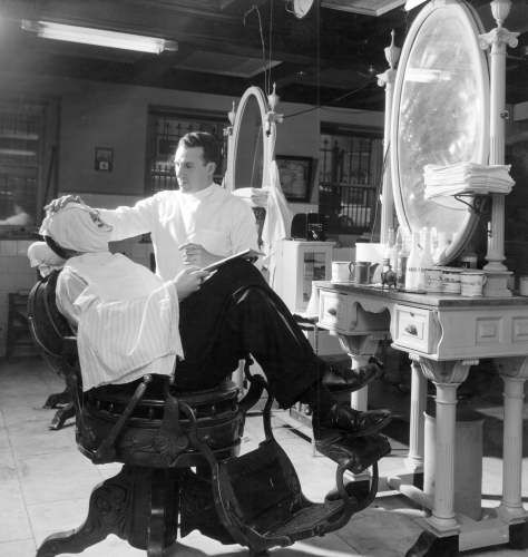 Maryland Club (Sandy Distephano) Date5/19/1957 Distephano with distinguished customer in one of the basement barber chairs