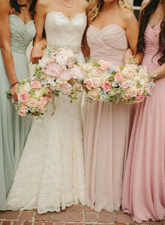 I LOVE everything about this look from the bouquets to the different colored pastel bridesmaid gowns!