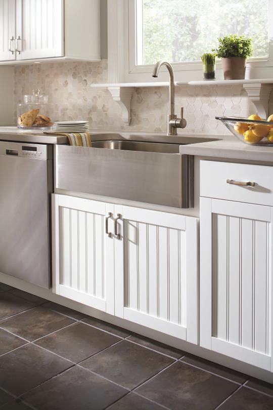 Aristokraft cabinetry 39 s traditional country sink cabinet for Stainless steel kitchen base cabinets