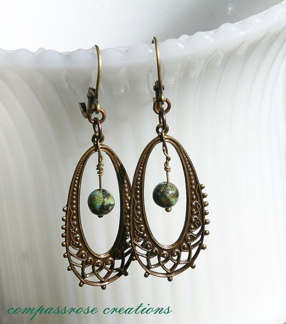 Hey, I found this really awesome Etsy listing at https://www.etsy.com/listing/114809617/brass-oval-filigree-hoops-with-african