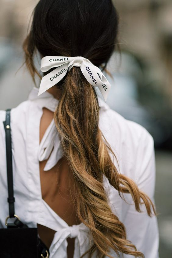 My designer hair ribbon is actually just ribbon from the box of my recent Chanel boy bag purchase! I decided to wear it in my hair since it was too cute to just toss aside… and I wanted to find another use for it.