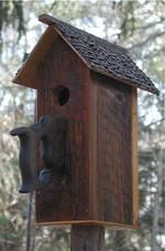 441B Rustic wood birdhouse on post with saw handle perch recycledbirdhouses.com