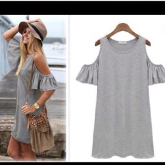 Gray tank/tunic.....never worn! Super cute....fits small....never worn Yipinyichu Tops Tank Tops