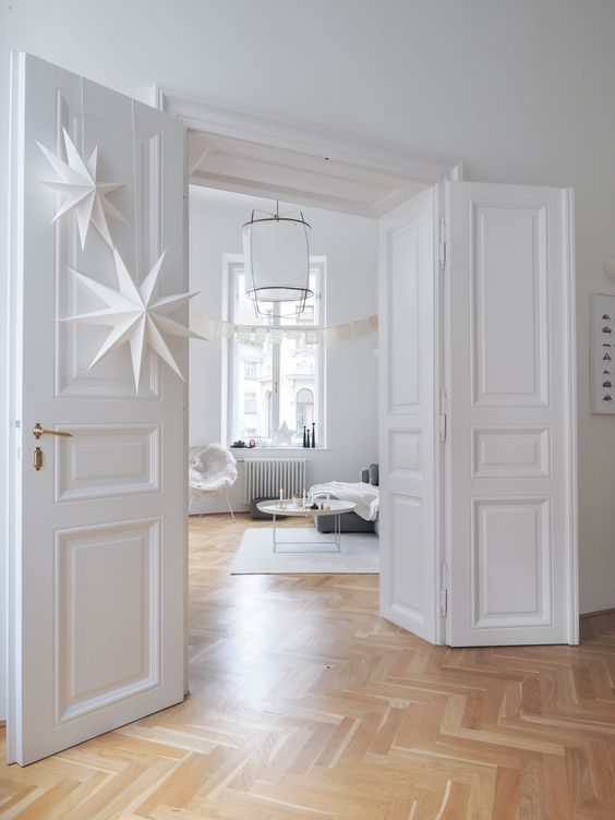 """""""We choose the apartment because we fell in love with the herringbone floors that are in every room, the four meter high walls, the big leaf doors and windows and the original brass door and window handles."""""""