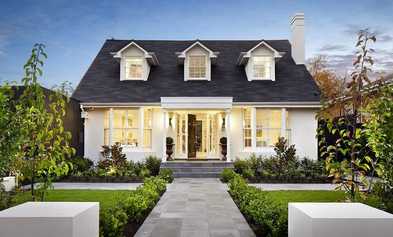 Beautiful example of a more modern cape cod design! LOVE the front facade and the modern back facade