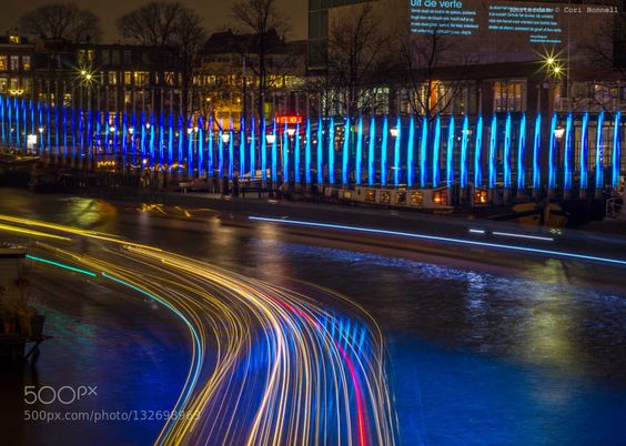 Around the curb - Pinned by Mak Khalaf The Amsterdam Light Festival has been going on for a few years. It's a good motivator to get out in the rain and take some night shots. Abstract Autumn 2015AmsterdamAmsterdam Light FestivalBlueLight trailsNight photoNight photographyPurpleWaterloopleinAmsterdam Opera HouseAmsterdam City Hall by farflungistan