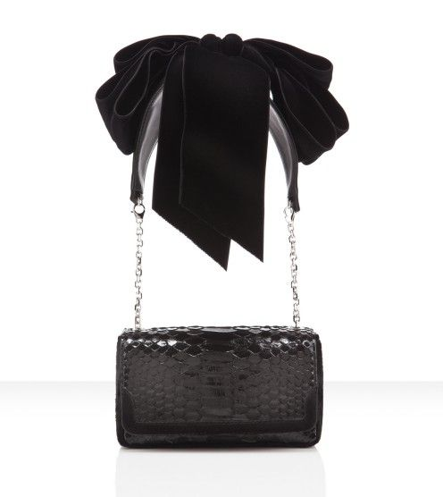 """Christian Louboutin - artemis python, bow, black, velvet  The Scoop:  Transform your look with the switch of a strap. As Msr. Louboutin said, """"These bags give a language to the upper body; they allow they allow a women to play with her shoulders. Her attitude will shift with each style, just like it does when she changes pumps."""""""