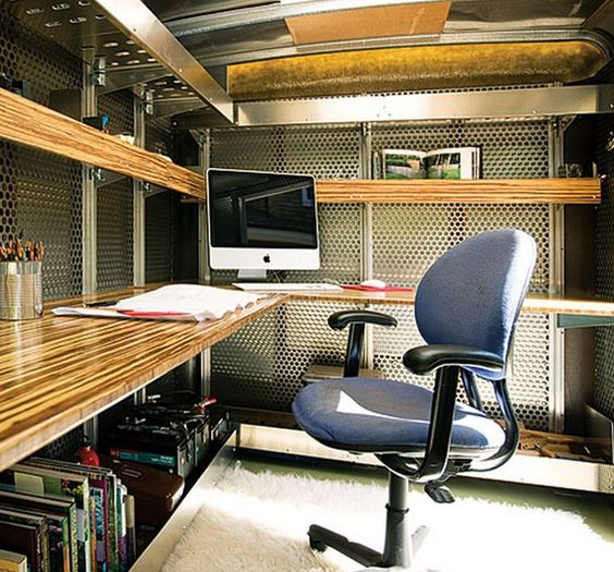 Utility trailer turned into a home office. Landscape architect Andreas Stavropoulos pulls it to worksites behind his Honda CR-V, and lives full time in an Airstream.