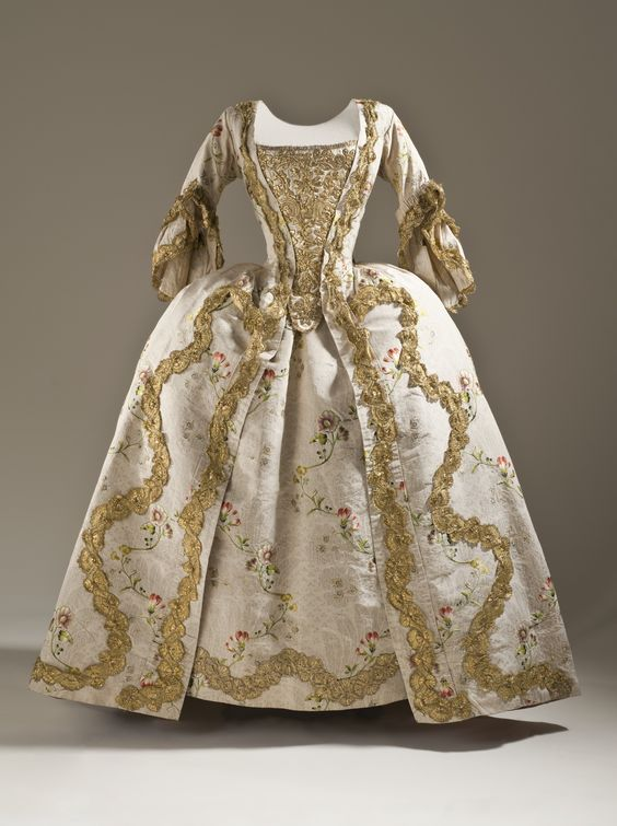 Robe à la Française and Petticoat, France or England, c. 1760-1765. Cream silk plain weave (faille) with silk and metallic-thread supplementary weft patterning, and metallic lace trim.