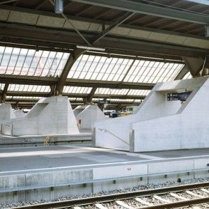 Sloping concrete circulation entrances added  to platforms at Zurich Hauptbahnhof