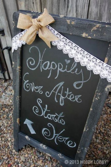 "Greet guests with a chalkboard wedding sign: ""Happily ever after starts here!"""
