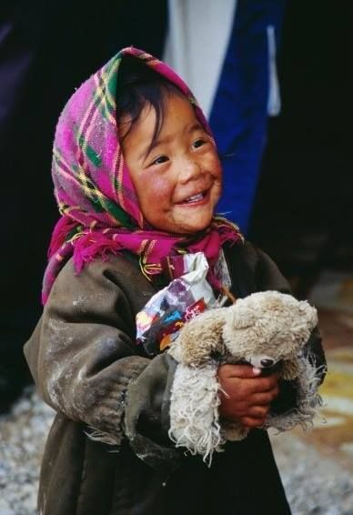 A gift of a teddy bear brings a smile