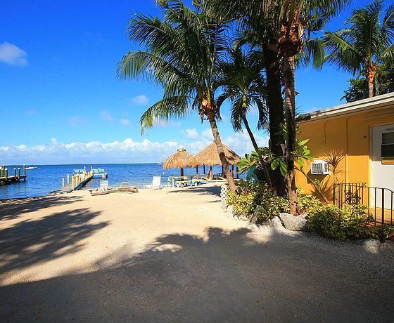 Sunset Cove Beach Resort In Key Largo Florida Keys Offers A True Island Atmosphere With Beautiful Private Beach Resorts Beach Accommodation Key Largo Vacation