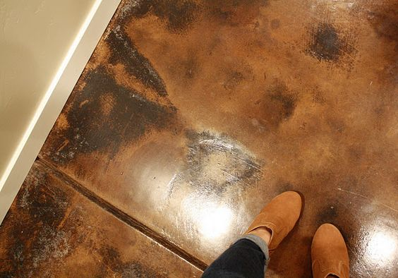 The painted copper colored cement floor was the show for How to clean concrete dust from floors