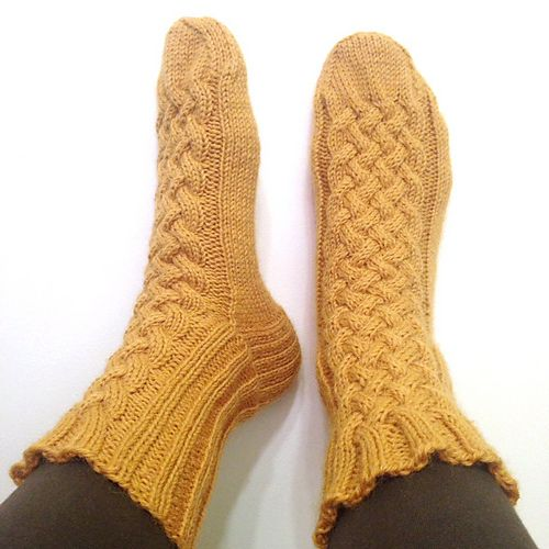 Mustard and cables socks. Includes a link to  the cable knitting chart.