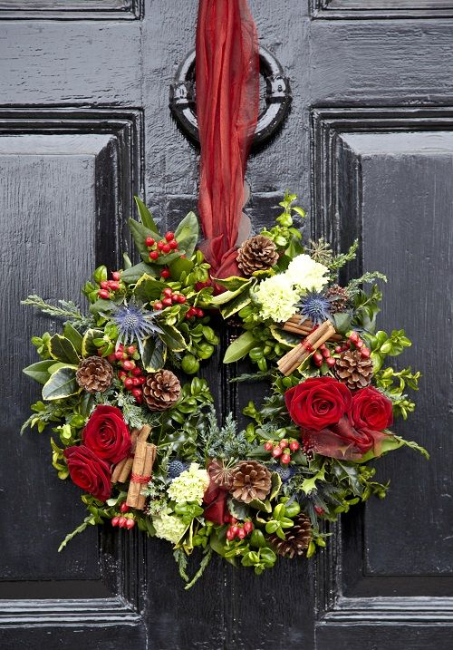 Christmas wreath with organza, pine cones, red roses, cinnamon sticks, red berries, Eryngium and foliage, using our oasis foam wreath
