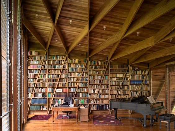 Bookshelf Inspiration by Architect Gianni Botsford  This library, found within the 'casa kike,' was designed by the multiple award winning architect Gianni Botsford.  This residence is located in Costa Rica and features a main studio space that contains this beautiful library, a writing desk, and piano. Study time and relaxation is definitely possible here.