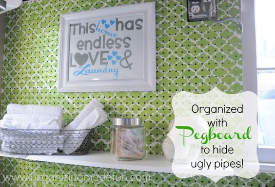 Laundry Room wall with pegboard to cover ugly pipes | OrganizingMadeFun.com