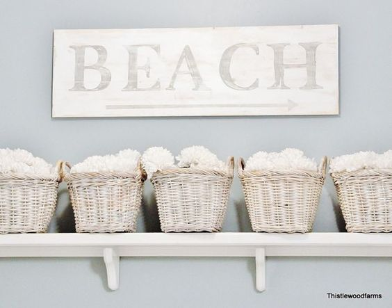 paint, stencil and distress a BEACH sign ... add a simple shelf and painted baskets for storage ..can also use this idea to  fix up the closets in your beach rental property.