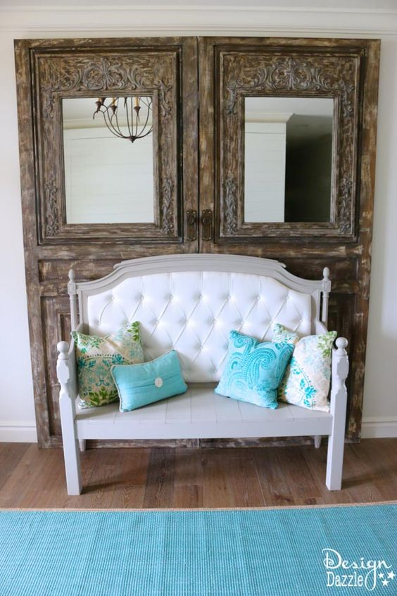"""Sharing fabulous ideas for an entryway room makeover. A sliding wall, """"old"""" vintage doors created from new pine & mirrors and a re-purposed headboard bench."""