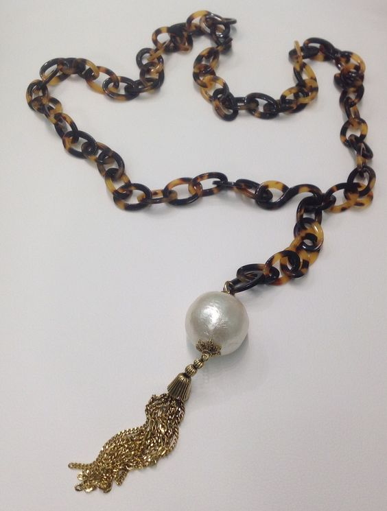 Lorren Bell's tortoise shell belt/necklace with cotton ball pearl pendant.