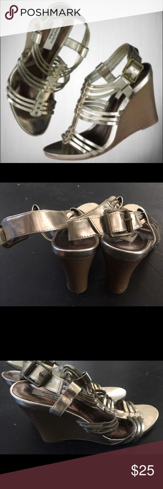 💕💖VERA WANG METALLIC GLADIATOR WEDGES💖💕 Simply Vera by Vera wang silver metallic wedges. Stacked wooden heel about 3 inches. Gladiator style with buckle at ankle. Great condition! Simply Vera Vera Wang Shoes Wedges