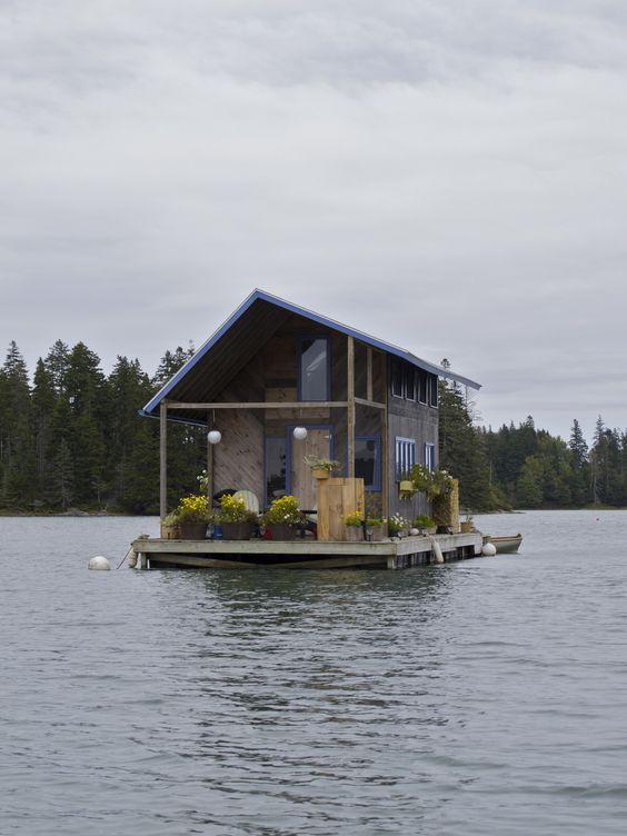 Hand-built floating cabin in Perry Creek, on the island of Vinalhaven, Maine.    Photographed by Marcus Peabody.
