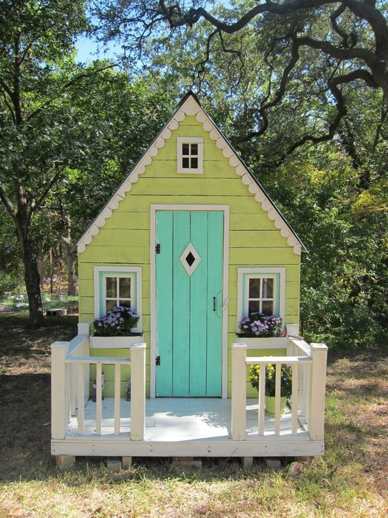 I don't think hubby would want to spend money on it, but I always wanted a playhouse like this as a kid! Maybe our kiddos will get one?: