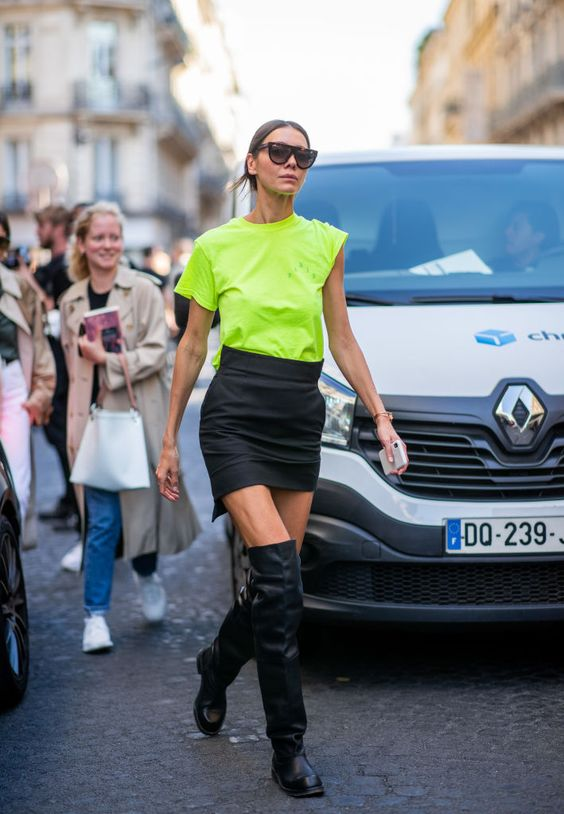 PARIS, FRANCE - SEPTEMBER 27: Julie Pelipas wearing neon tshirt, black mini skirt, black boots is seen outside Y/PROJECT during Paris Fashion Week Womenswear Spring/Summer 2019 on September 27, 2018 in Paris, France. (Photo by Christian Vierig/Getty Images)