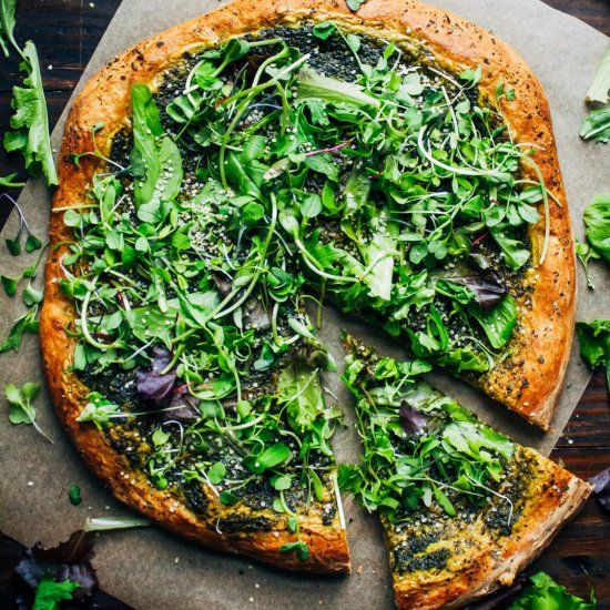 This green goddess pizza might be the best vegan pizza you'll ever have, with cashew cheese, topped with fresh greens!