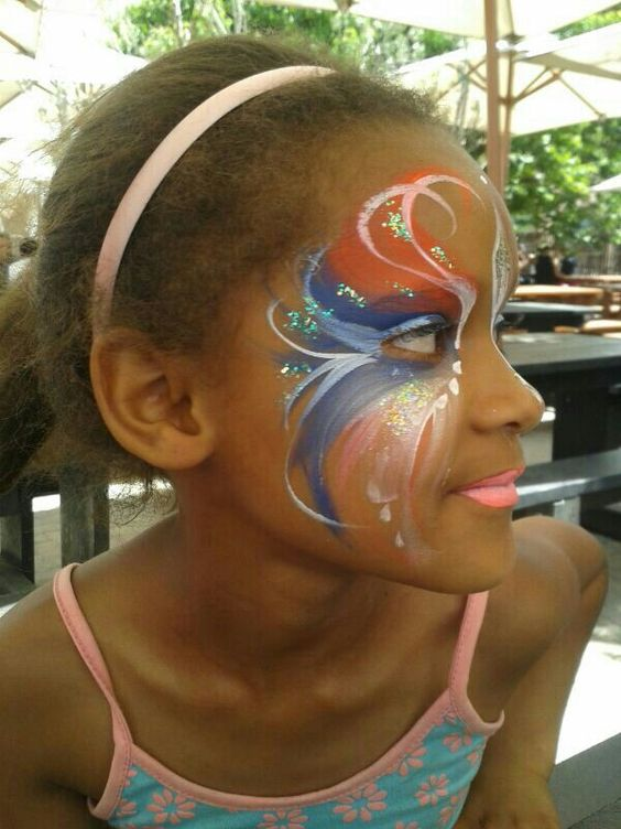 Bright and sparkly face painting.