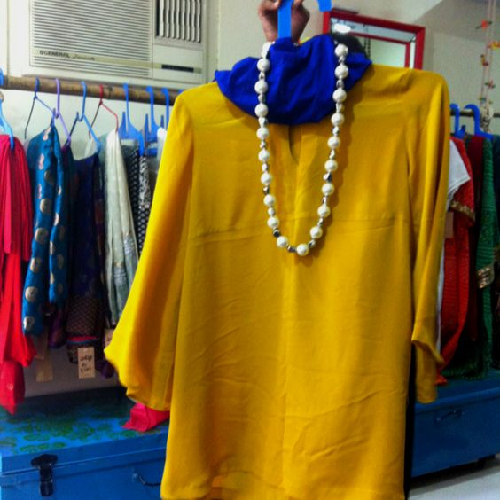 Mustard dressy shirt with pearls for an evening out. Wear with white pants and blue heels. Facebook: Ay Clothes and Accessories.
