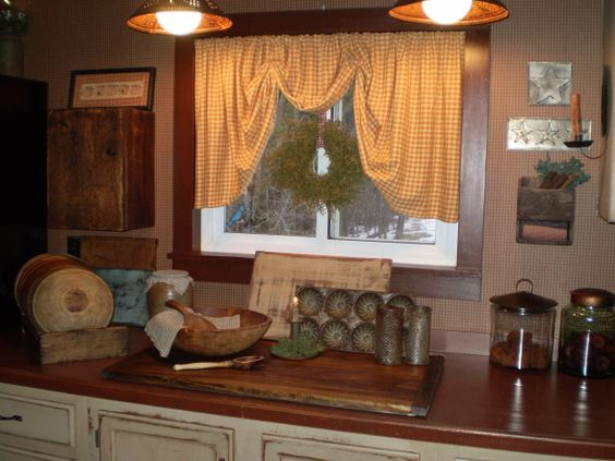 The wreath in the center of the window draws attention to for Country dining room color ideas