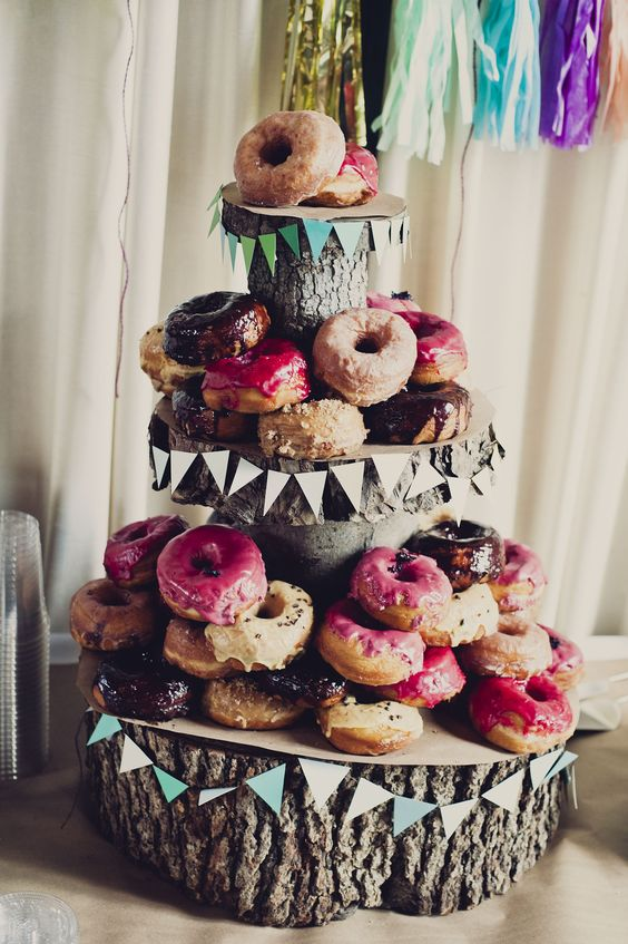 Not feeling the idea of a cake for a brunch wedding? Go with donuts for a quick and easy dessert everyone will love! #weddingideas