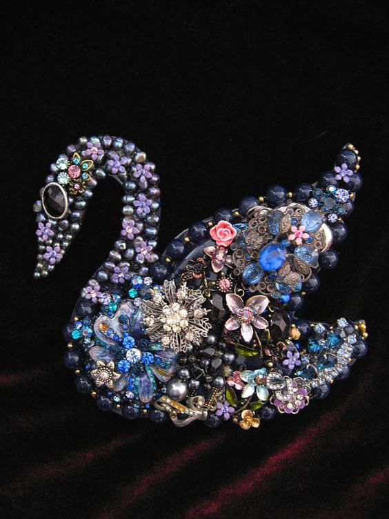 This gorgeous swan is hand layered with vintage rhinestone jewelry including enamel, freshwater pearls, earrings, brooches, vintage crystals,