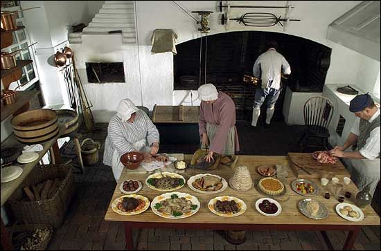 Members of the historic foodways department prepare food for Williamsburg craft house catalog
