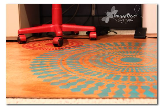 """Plywood """"rug"""" instead of the ugly plastic ones for the office chair rollability."""
