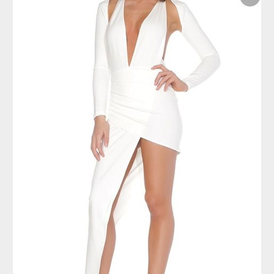 Symmetrical white dress Symmetrical cut size small long sleeve white midi dress. This is a FEMME brand dress I put it under missguided for exposure due to this brand not being as popular yet. Open back. Never worn out except to take this picture Missguided Dresses Asymmetrical