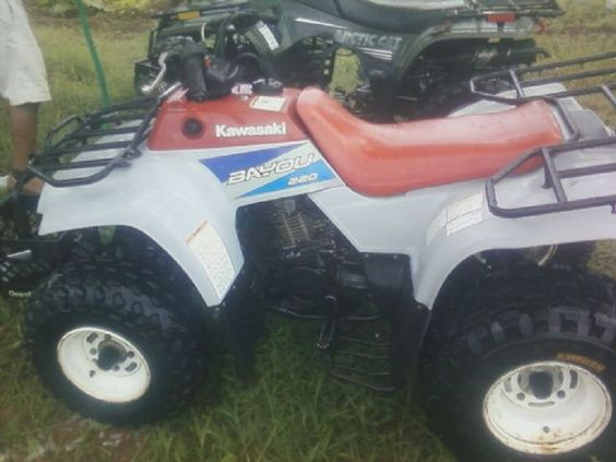 1995 kawasaki bayou 220 4-wheeler , red/white, 200 hours for sale