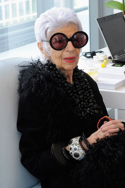 Love her!! muah, muah....Iris Apfel in black (ten strand necklace) for Vogue Deutsch / smokin'!!