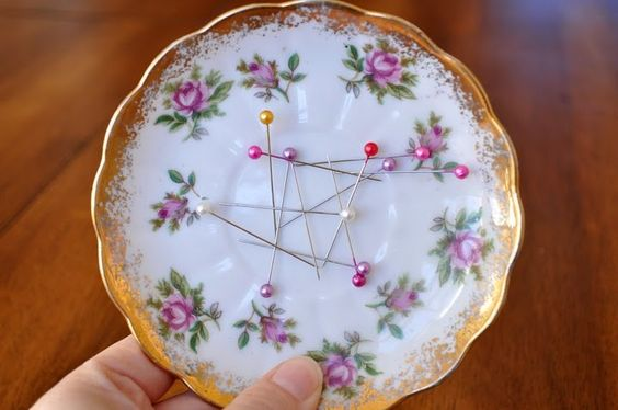 huh!  smart...glue magnets to the back of a dish for instant pin cushion