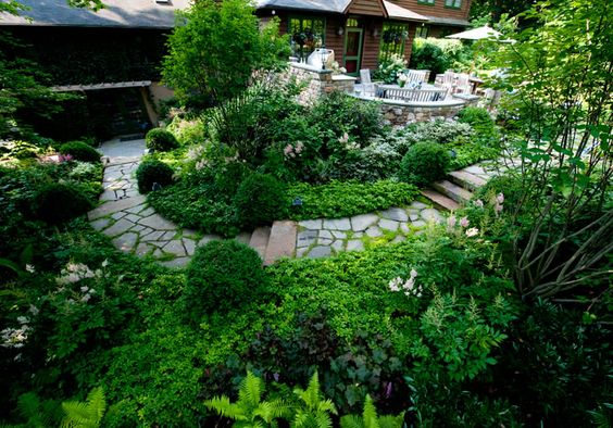 someone actually has this luscious beautiful back yard with winding path stone patio!