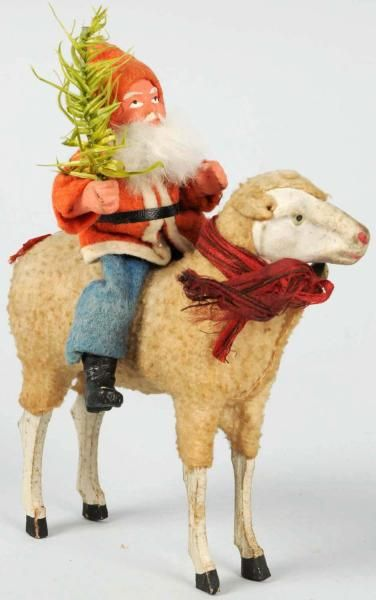 """Santa Riding Putz Stick Leg Sheep.  Sheep is wearing red ribbon with brass bell, red ribbon on tail,  Size 6 - 1/2"""" T."""