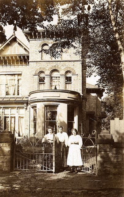 Three ladies at the gate of a very large house by lovedaylemon, via Flickr