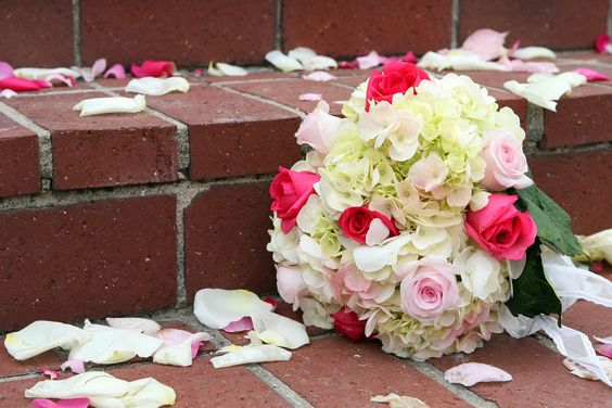"""Bouquet toss alternative: """"I ordered three small """"toss bouquets,"""" gave a """"Thank you"""" speech to our parents, and passed out the bouquets to our mothers. The moms loved the surprise and the sentiment; my still-single relatives were grateful for the toss-reprieve."""""""