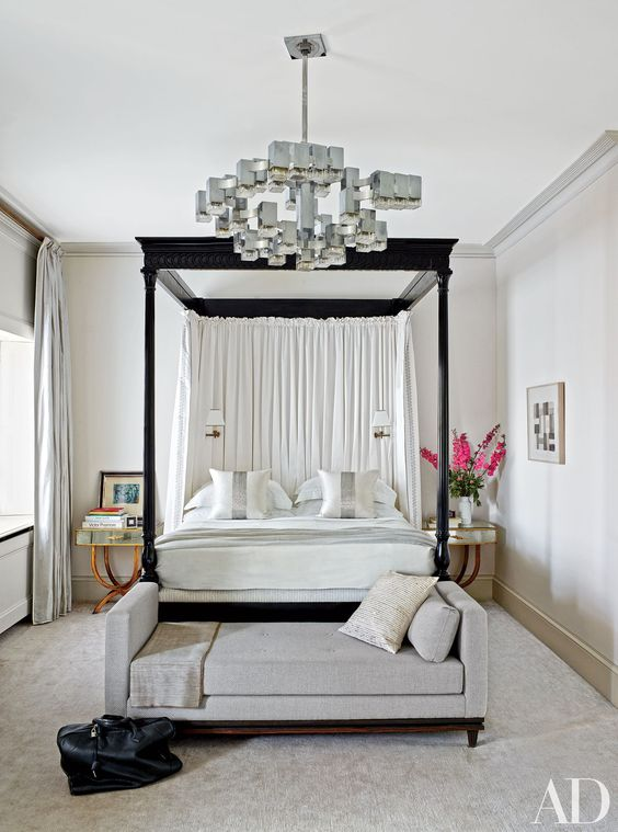 This amazing light fixture adds an art deco feel to a bedroom in London.