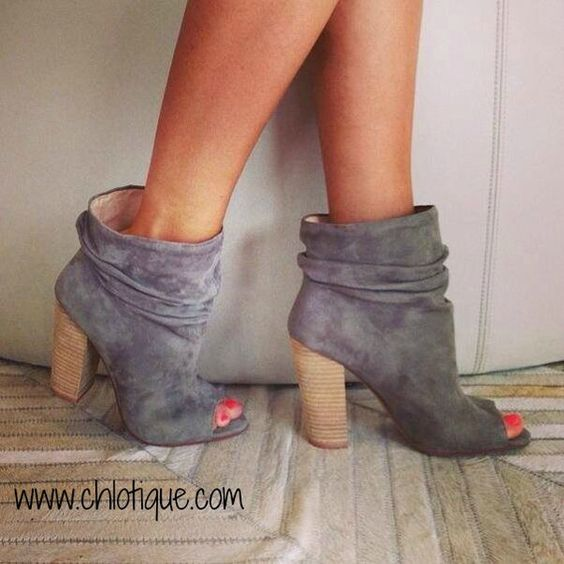 Wake up your wardrobe with these high-style Break Up booties with slouchy ankle detail and a flirty peep-toe. From Chinese Laundry.Suede upperRound open peep-to