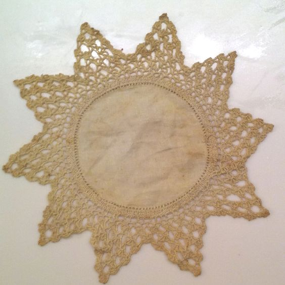 Delicate hand crocheted doily